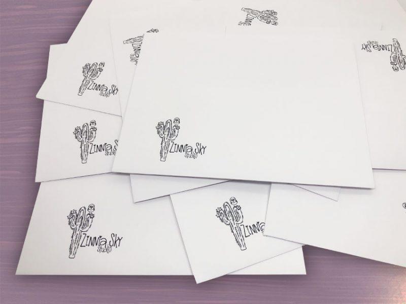 envelope white zinnia sky studio